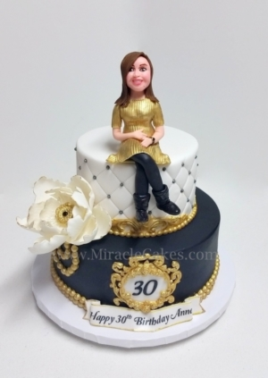 30th Birthday cake with a figurine topper