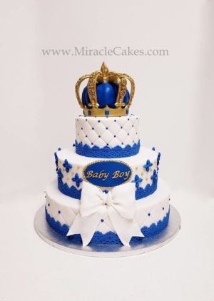 Baby shower cake with a crown topper.