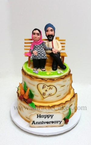 Anniversary cake with figurine toppers