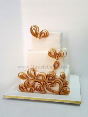 White and Gold modern wedding cake