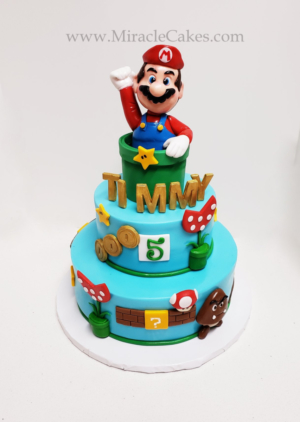 Super Mario brothers cake with a hand made topper.