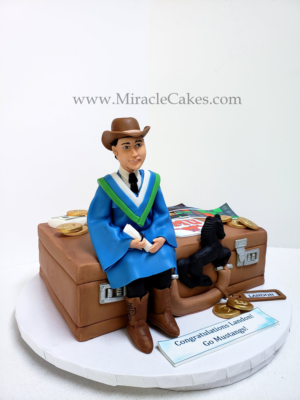 Graduation cake with a figurine topper