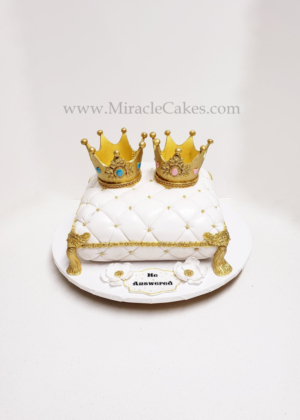 Pillow cake with two crown toppers for twins baby shower