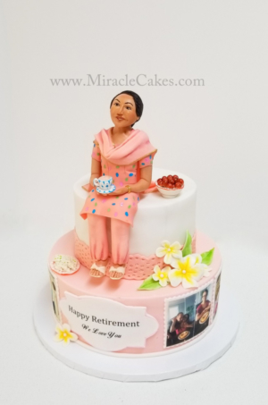 Retirement cake with a handcrafted figurine. Having Chai tea and Indian sweets