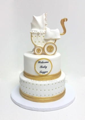 White and Gold themed baby shower cake with a 3D carriage topper