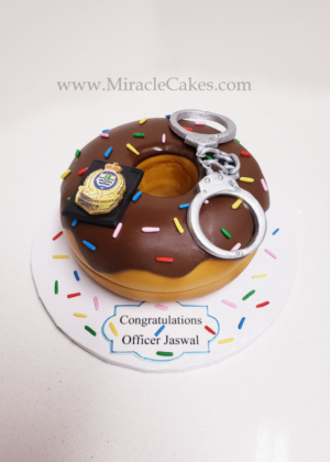 Donut cake with edible hand cuffs for a officer who is graduating