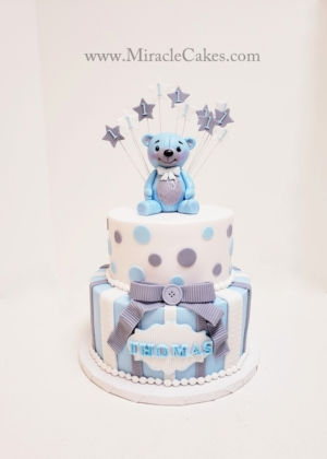 Blue, Grey and White cake with a Baby bear topper