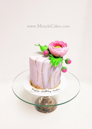 Simple and elegant cake with gum paste flowers