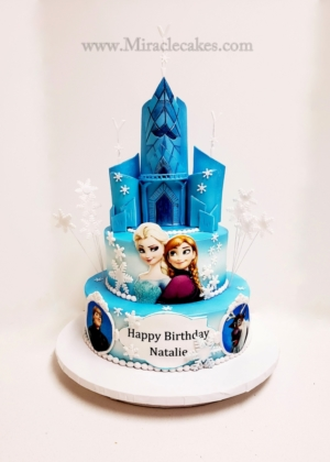 Frozen cake with the castle topper