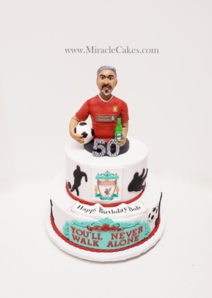 50th birthday cake with a figurine topper