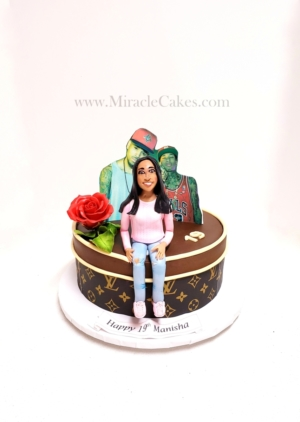19th Birthday cake with a figurine topper