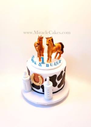 First birthday cake with handmade horse toppers.
