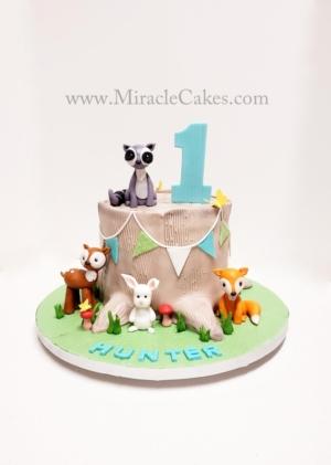 Woodland animals first birthday cake