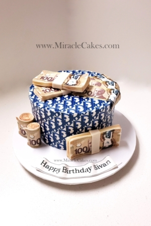 Dior themed cake with edible money.