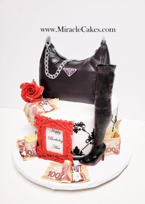 Designer cake with a knee high boot and a purse