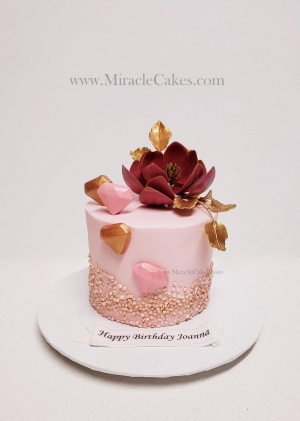 Simple birthday cake with a sugar flower
