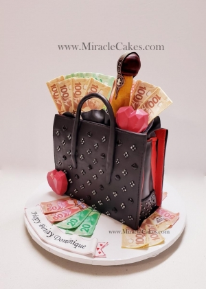 Designer Purse cake with edible money on top