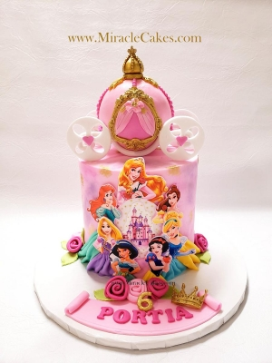 Princess cake with a carriage topper