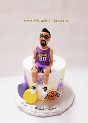 Lakers theme cake with a personalized figurine topper