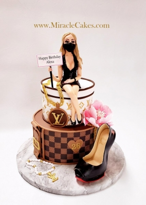 LV cake with a personalized figurine topper