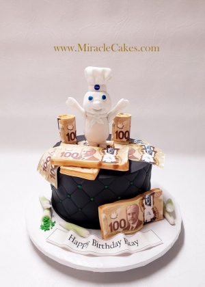 A cake with the Dough boy topper and bundles of money