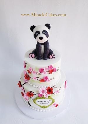 Cute panda bear and cherry blossoms cake