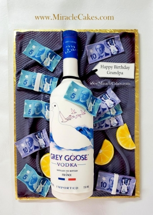 Grey Goose Vodka bottle cake with edible bills