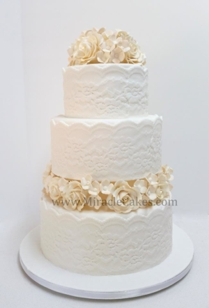 Off white wedding cake with Ivory color flowers
