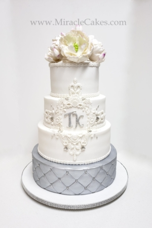 Silver and white wedding cake with gum paste Peonies